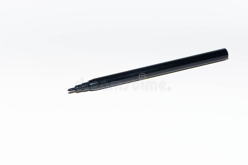 Black felt-tip pen. On white background, marker, isolated, sharpie, checklist, object, paper, art, equipment, education, school, ink, writing, utensil, design royalty free stock photography