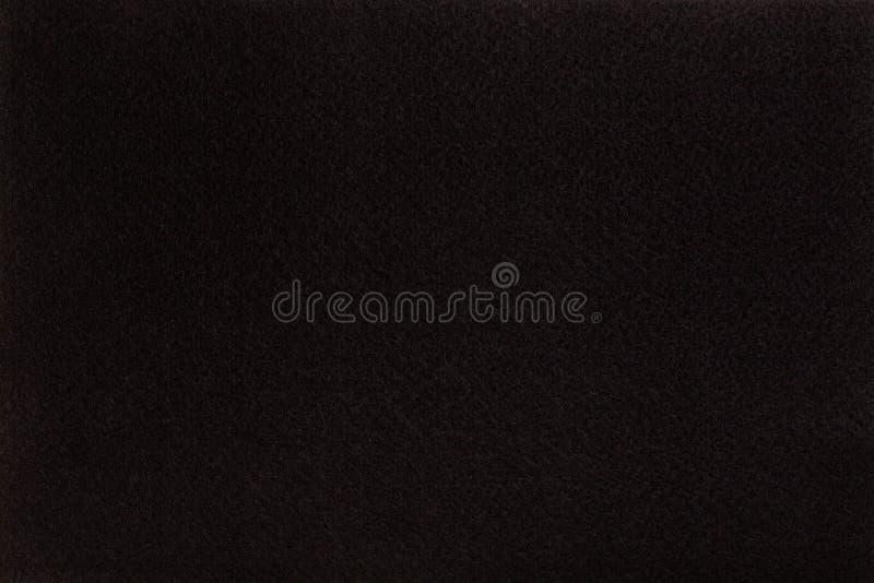 Black felt tissue cloth, closeup texture background stock photography