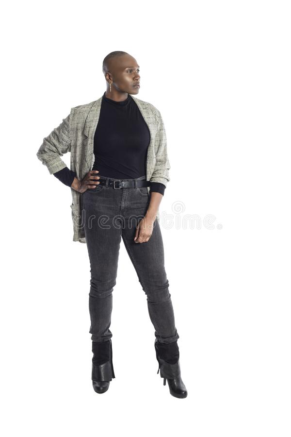 Black Female Fashion Model Wearing Business Casual Attire. Black African American woman looking confident while wearing modern business casual outfit on a white royalty free stock image
