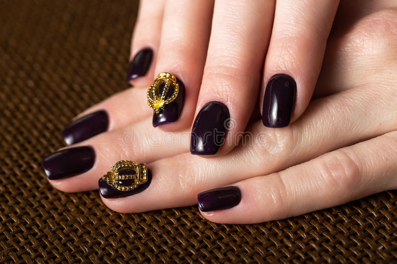 Black female manicure nails closeup with crown royalty free stock image