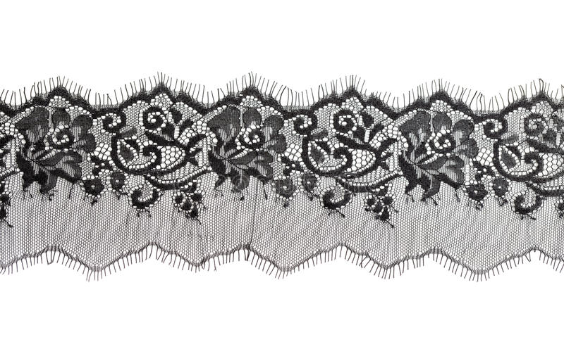 Black fine lace floral texture. Isolate on white stock photography