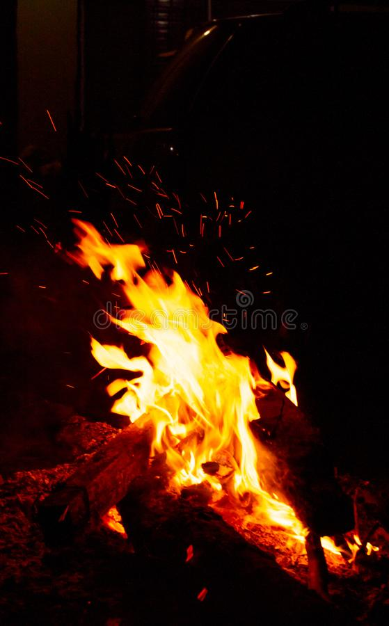 Black fire in the darkness stock photography