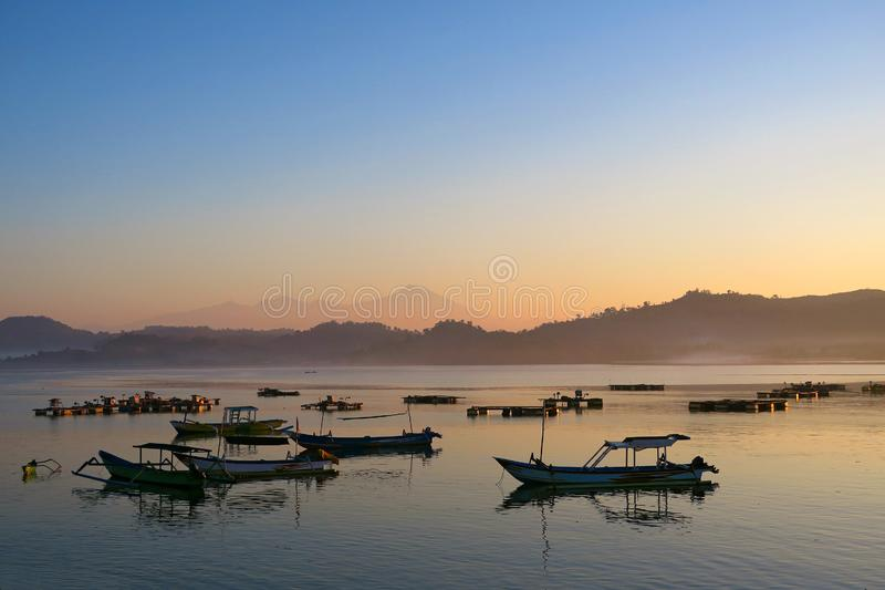 Black fishermans boats silhouettes in the morning at Lombok island, Indonesia royalty free stock photos