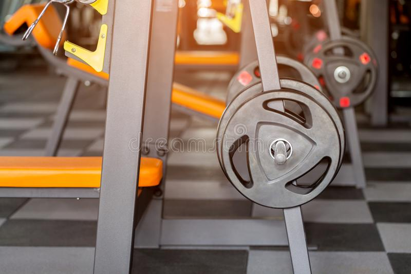 Black fitness cycle wheel closeup in the gym royalty free stock photo