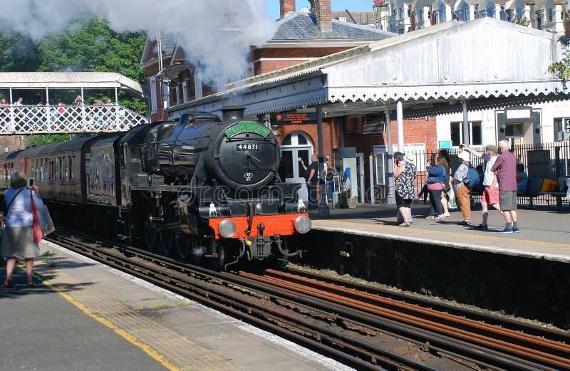 Black Five steam locomotive, St. Leonards. London Midland and Scottish Railway Class 5 steam locomotive, 44871, hauls an excursion train through St. Leonards stock images