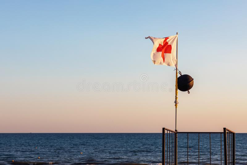 Black flag on the beach prohibiting swimming in the sea. With copy space royalty free stock image