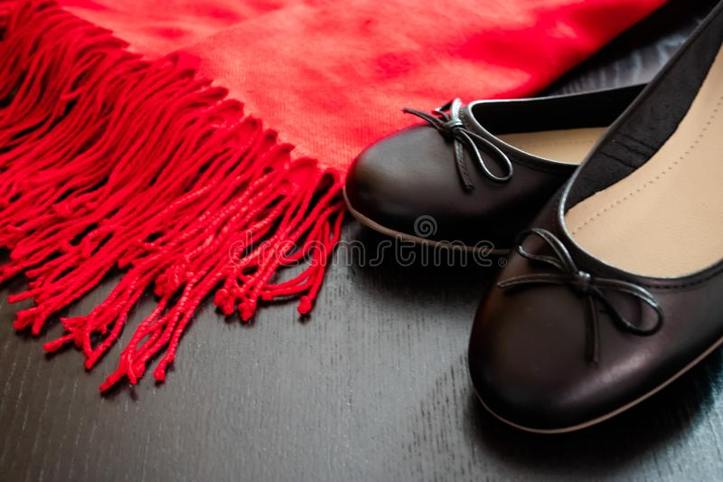 Black flat shoes with the red scarf stock photos