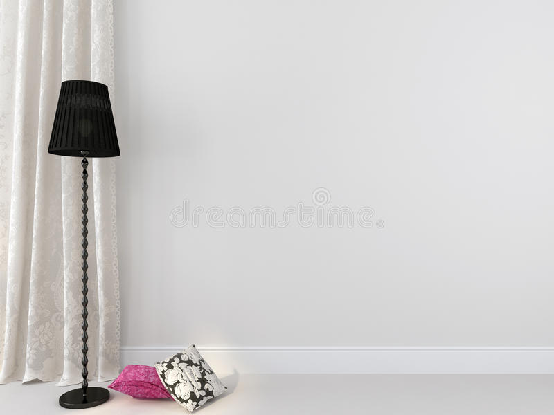 Black floor lamp against a white background. Elegant black floor lamp and colored pillows against a white wall and curtains royalty free stock photo