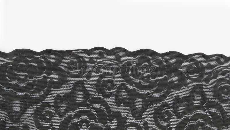 Black floral lace band background. Black floral lace band texture useful as a background royalty free stock photo