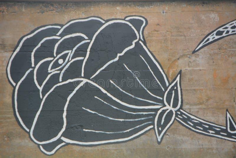 Black flower graffiti in SE Portland, Oregon. This is black flower graffiti decorating a building wall in SE Portland, Oregon`s industrial area stock image