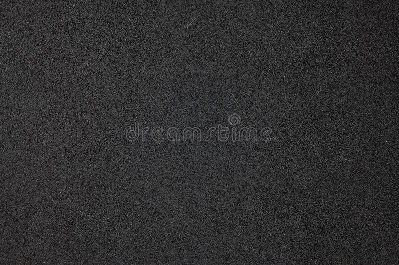 Black foam surface. Absorb, abstract, backdrop, background, beauty, blank, bubble, clean, close, closeup, dark, design, detail, element, froth, grainy, gray royalty free stock photo