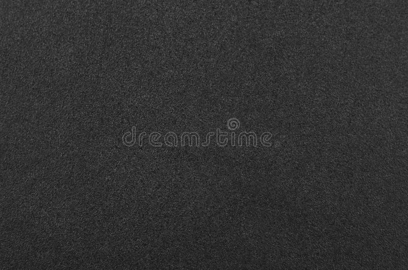 Black foamed rubber. Close up as background royalty free stock image