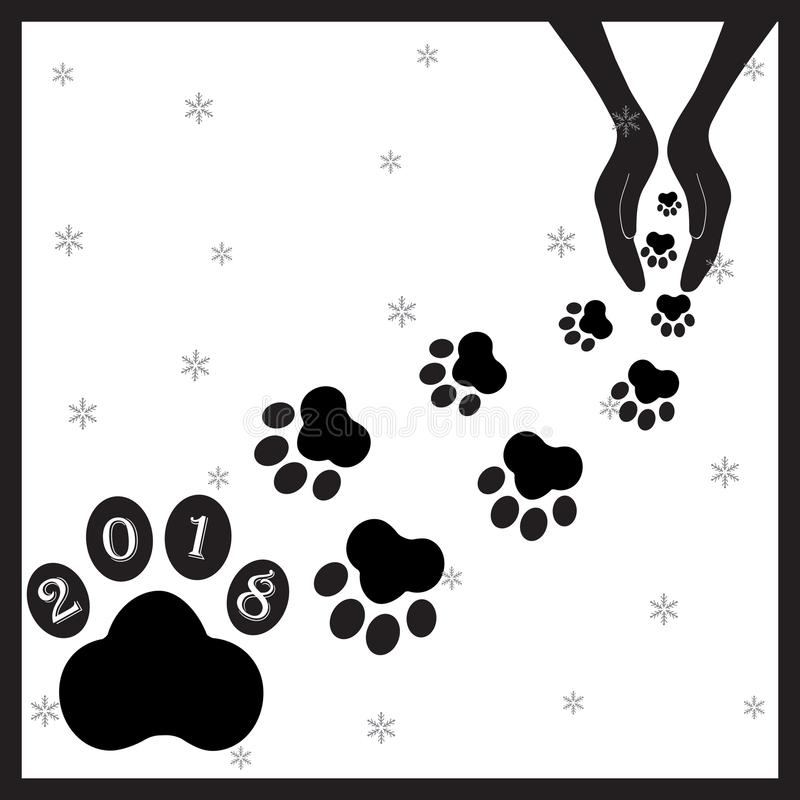 Black footprints dogs in hands3 stock photography