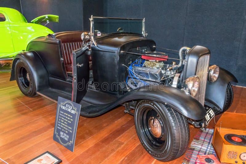 Black 1930 Ford roadster hot rod car stock image