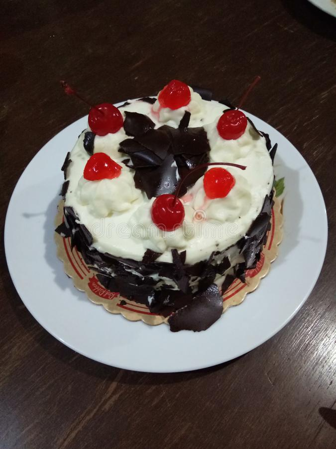 Black Forest Birthday Cake with Cherry royalty free stock image
