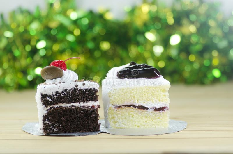 Black forest cake and blueberry cake. With bokeh background royalty free stock image