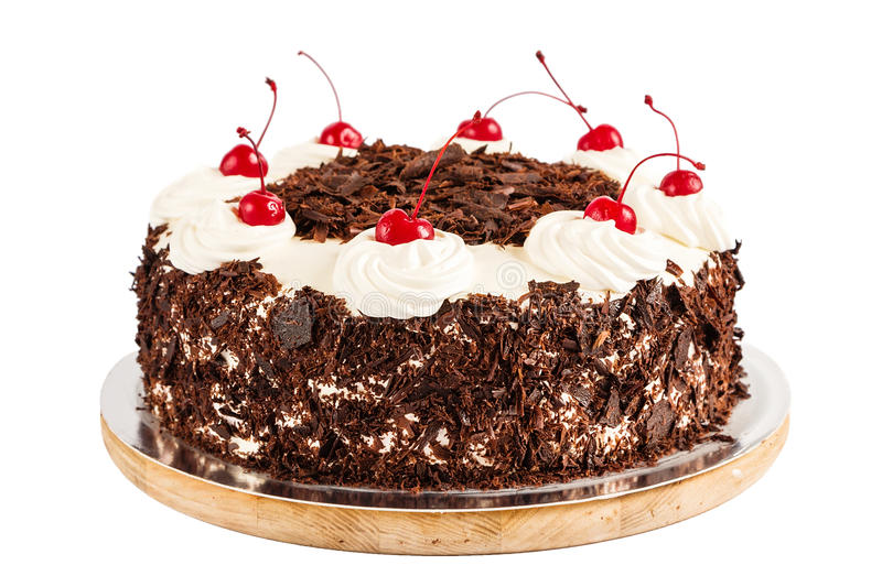 Black forest cake decorated with whipped cream and cherries royalty free stock image