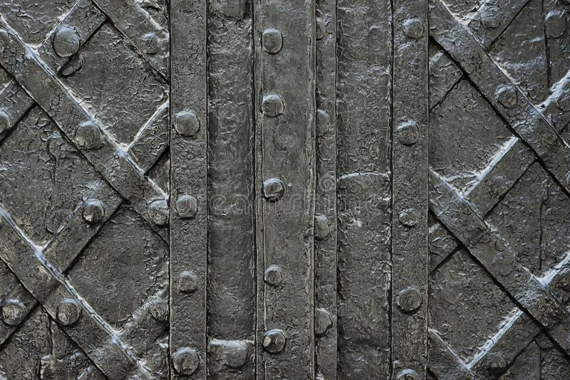 Black forged iron door for texture or background, ancient architecture of castle gate backdrop stock photography