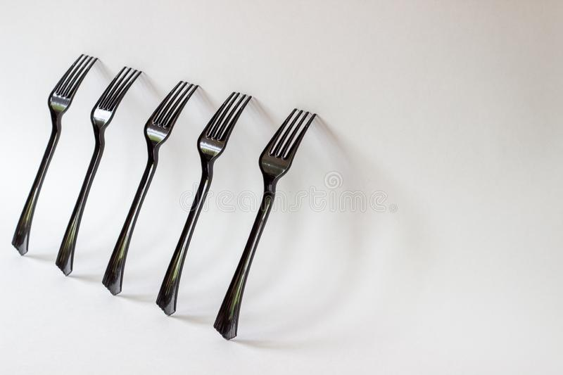 Black forks on a white background. Minimal concept. Abstract stock images