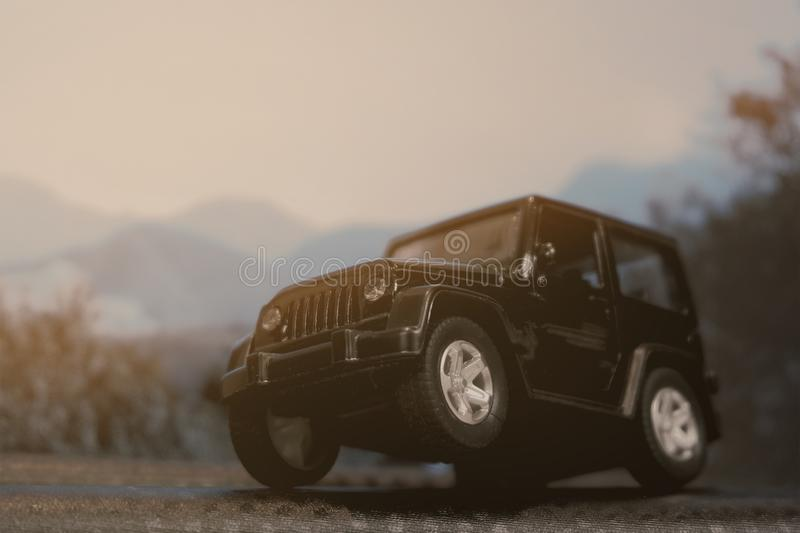Black four wheel drive car, explore in the forest. Rural, texture, vehicle, automobile, land, track, tire, dirty, nature, countryside, summer, control royalty free stock photography