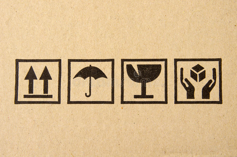 Black fragile symbol on cardboard stock photography