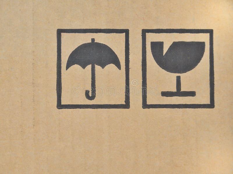 Black fragile symbol on cardboard. stock photos