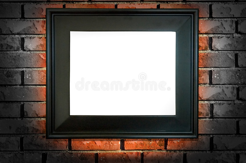 Black frame. A black frame on a brick wall with a red glow and insert area for copy or an imagery