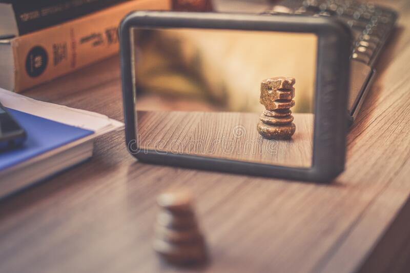 Black Frame Mirror on the Brown Wooden Table royalty free stock image
