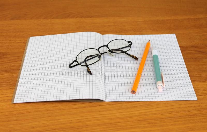 Black Framed Eyeglass on Graphing Paper royalty free stock photos