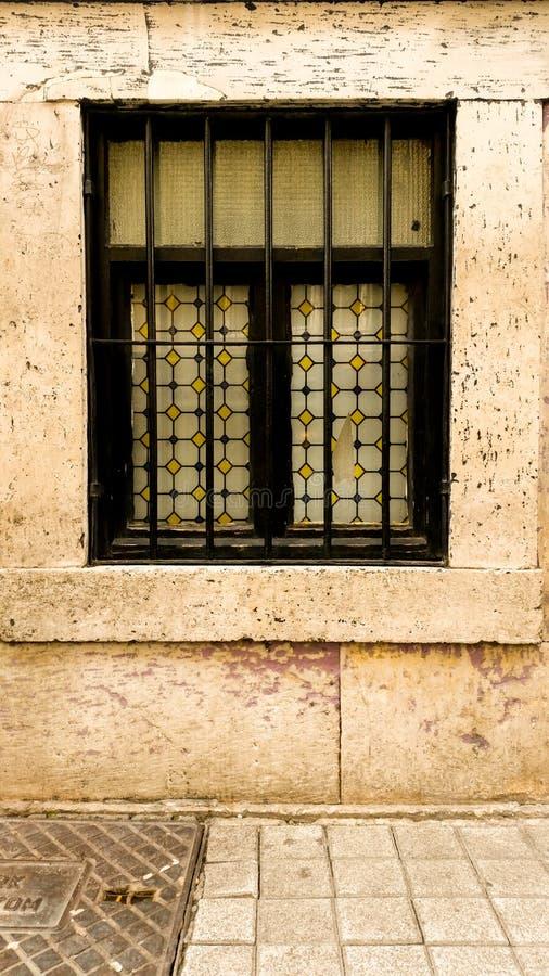 Black framed fenced window. Close up of a black framed fenced window stock images