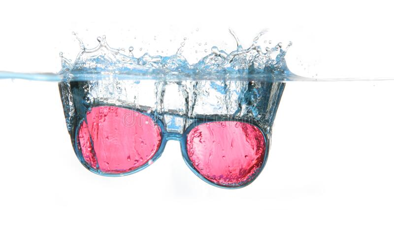 Black Framed Red Aviator Sunglasses on Water royalty free stock photo