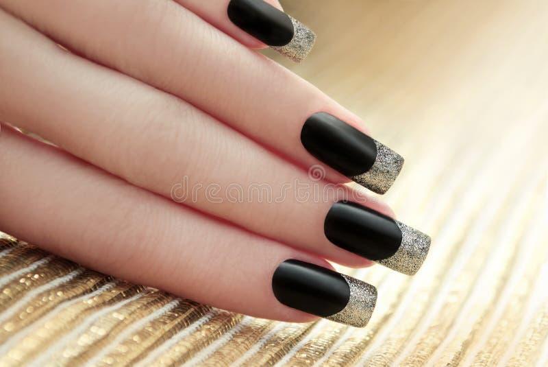 Black French manicure. stock photo