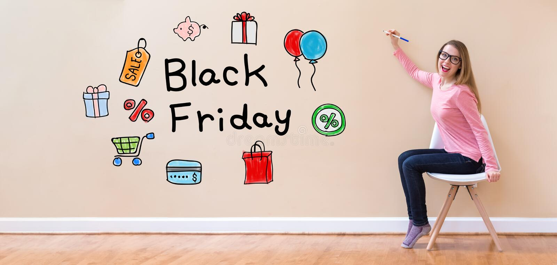 Black Friday avec la jeune femme tenant un stylo photos libres de droits