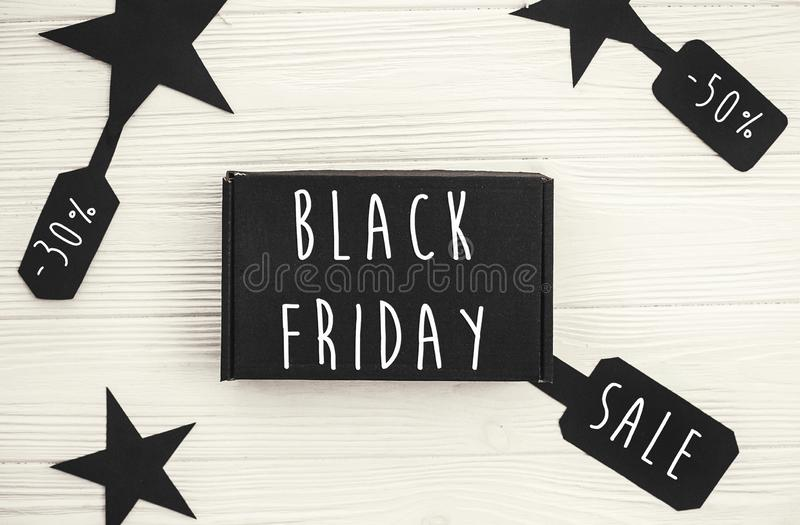 Black Friday big sale text on price tag sign, minimalistic flat. Lay. Special discount christmas offer. Stylish advertising message at black gift boxes on white royalty free stock photography
