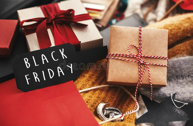 Black Friday big sale text sign. Special discount christmas offer. Advertising message at gift boxes, price tags, credit cards, m. Oney, bags, wallet on rustic stock image