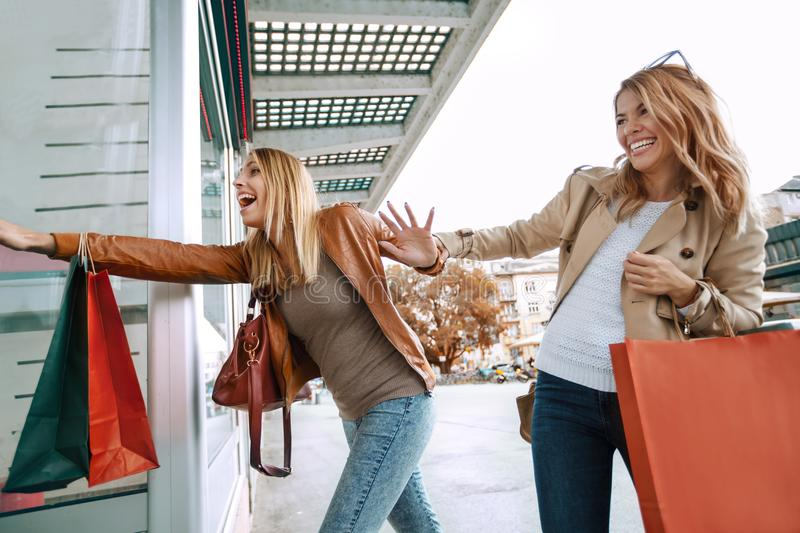 Black friday concept.Happy friends shopping. stock images