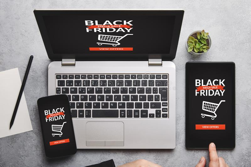 Black friday concept on laptop, tablet and smartphone screen stock photos