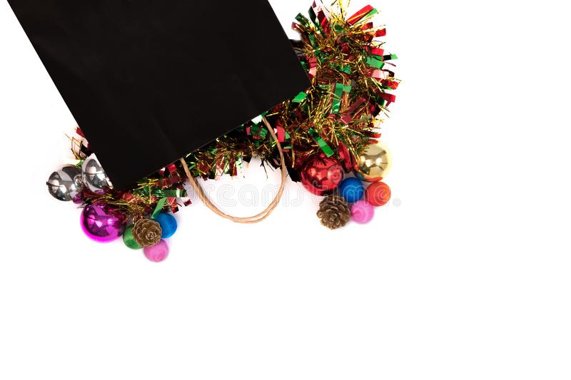 Black friday concept. Overhead shot of black bag with christmas stock images