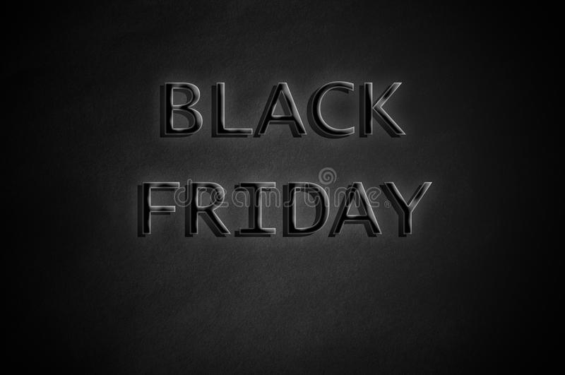 Black Friday on dark paper background stock photography