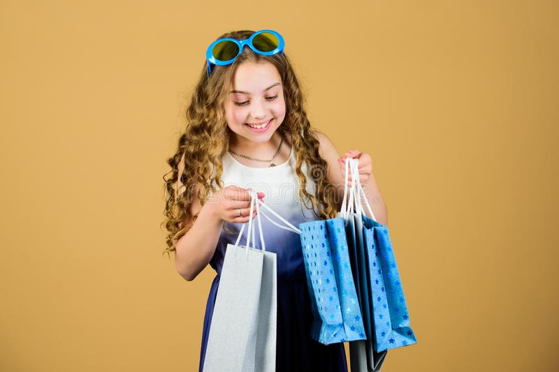 Black Friday discount. happy shopping girl with bags. summer sales. Small girl fashion. happy birthday holiday. Beauty. Cyber Monday. Present and gifts buy stock photos