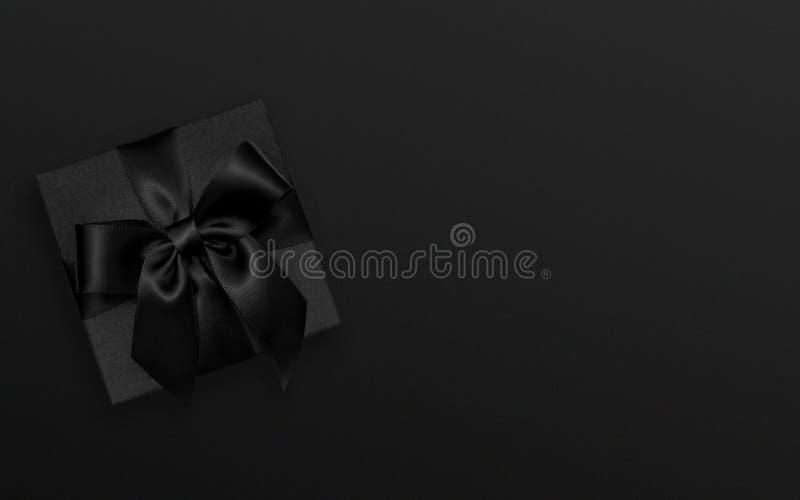 Black Friday-Geschenk, Weihnachtsgeschenk auf schwarzem Hintergrund stockfotografie