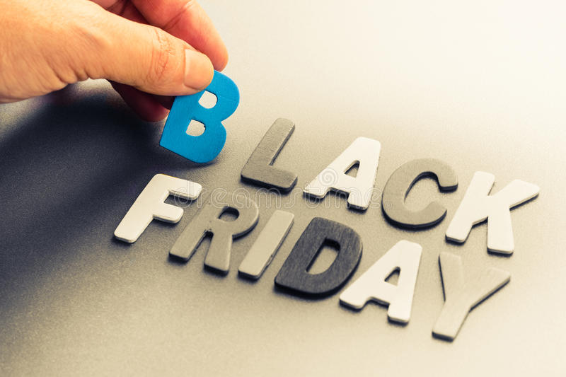 Black Friday. Hand arrange small wood letters as Black Friday topic