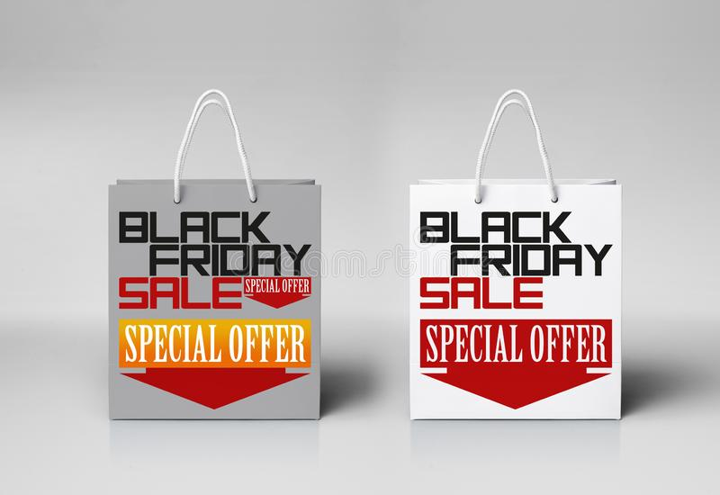 Black Friday paper bag at the white color background with woman hand. Promotional concept stock image