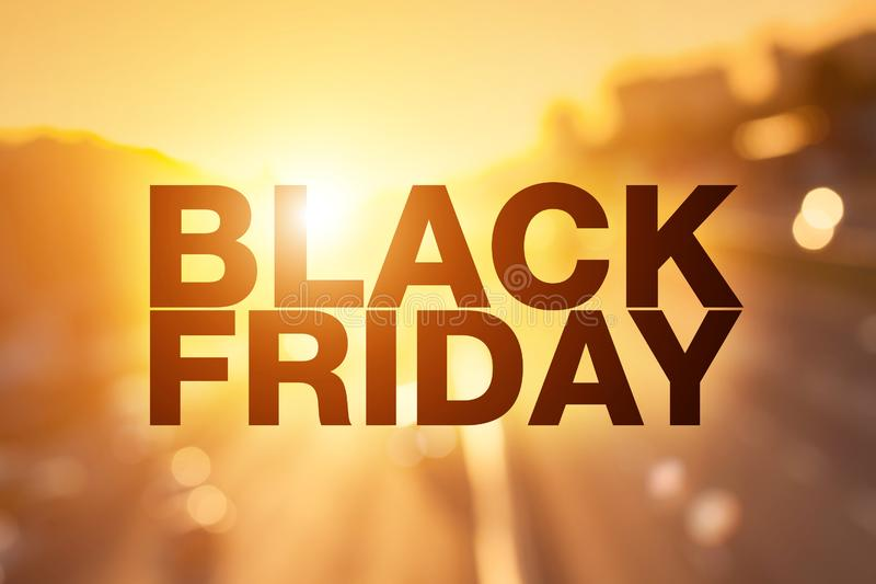 Black friday poster. Blurry sunset cityscape on background royalty free stock images