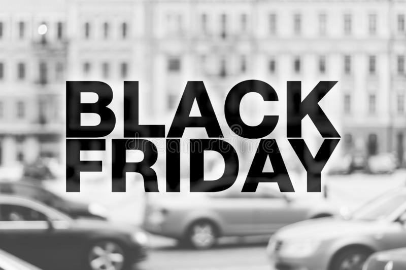 Black friday poster. Blurry noir cityscape on background royalty free stock photos