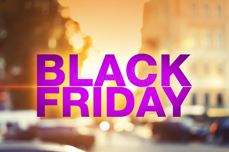 Black friday poster. Blurry sunset cityscape on background royalty free stock photography