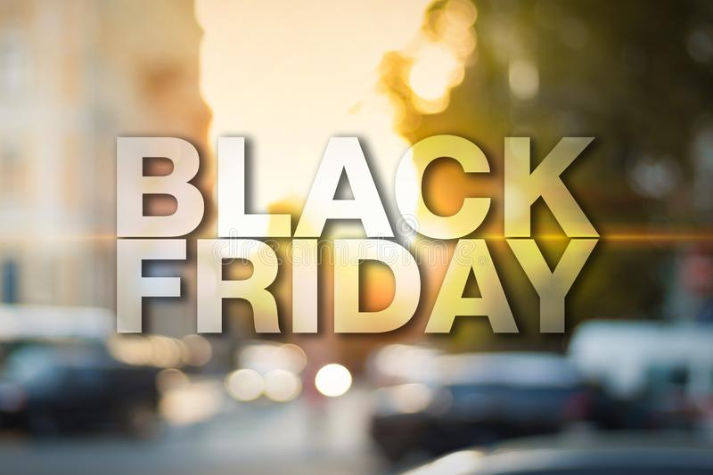 Black friday poster. Blurry sunset cityscape on background royalty free stock photo