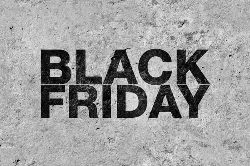 Black friday poster. Inscription on concrete surface stock photo