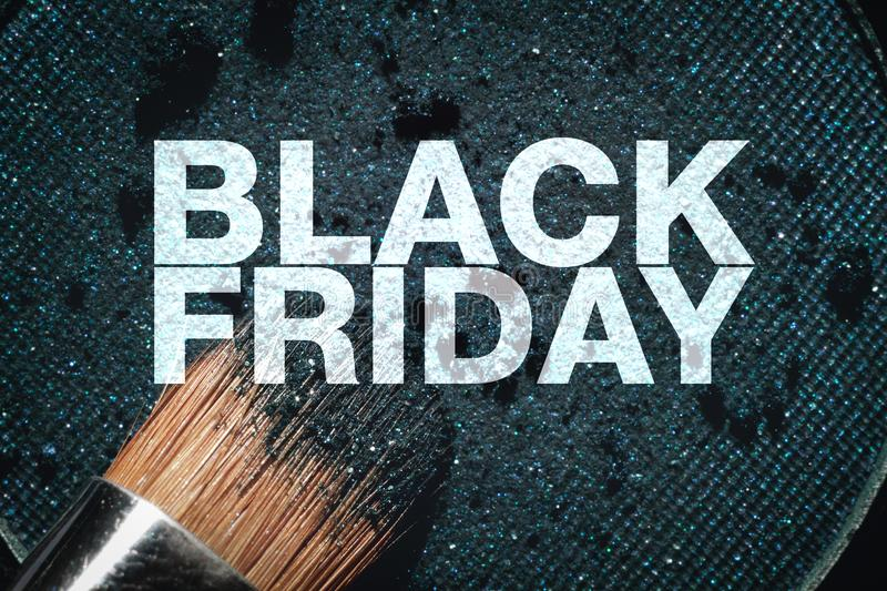 Black friday poster. Macro eyeshadow refill and brush stock images