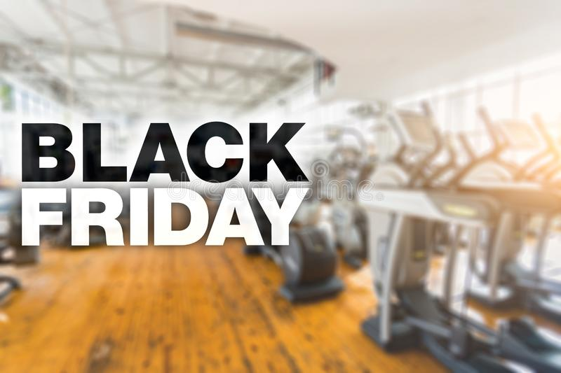 Black friday poster. Place for text. Blurry gym on background royalty free stock image